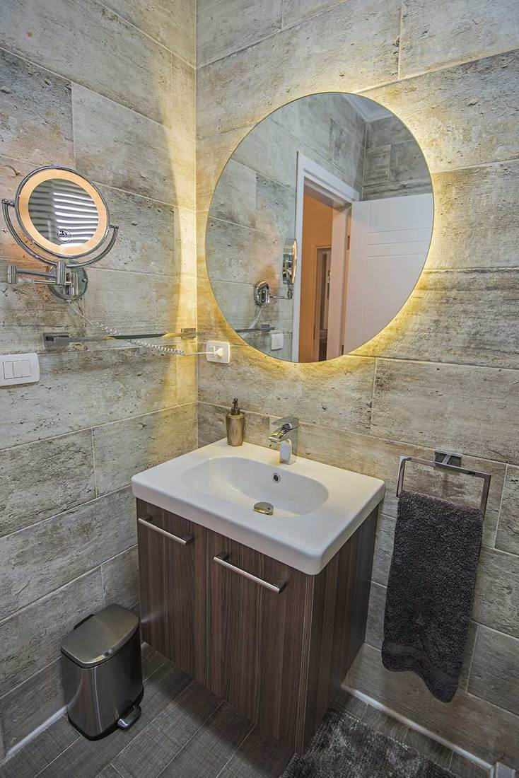 Interior design of a luxury show home bathroom with mirror and sink