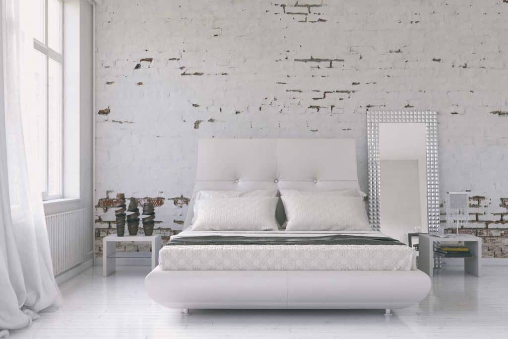 Luxury white industrial bedroom with large white floor mirror