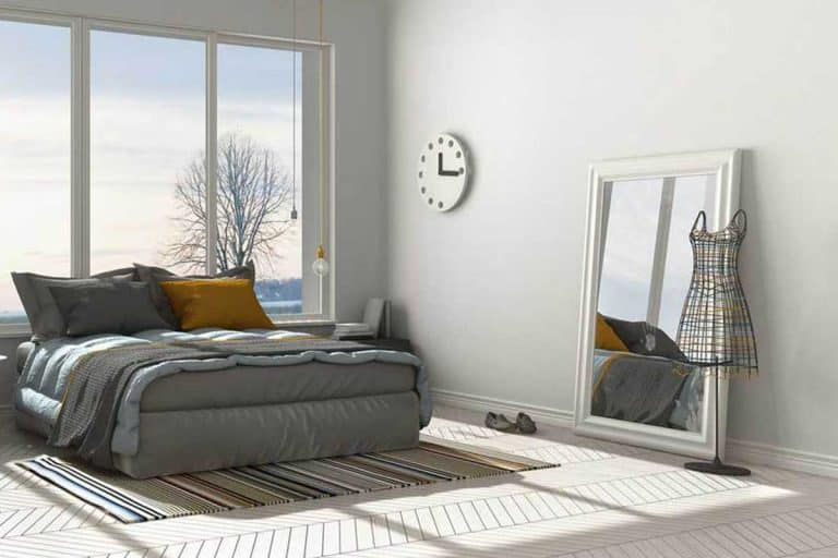 Modern white bedroom with floor mirror that has reflection of the room windows, 37 Floor Mirror Decorating Ideas