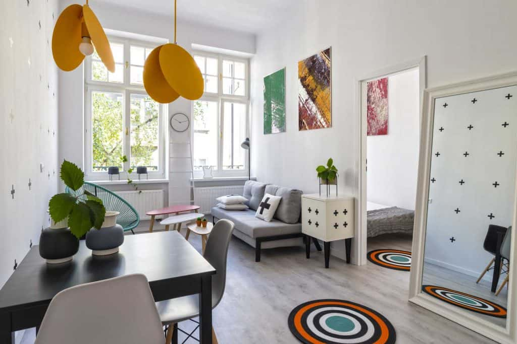 Scandinavian interior with colorful decors including a floor mirror
