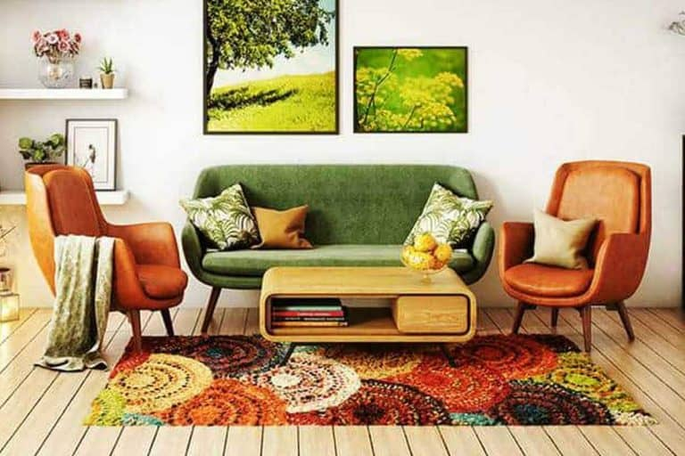 70s style living room interior design with hardwood floor, carpet and green couch, What Goes With A Green Couch [16 Examples to Follow]