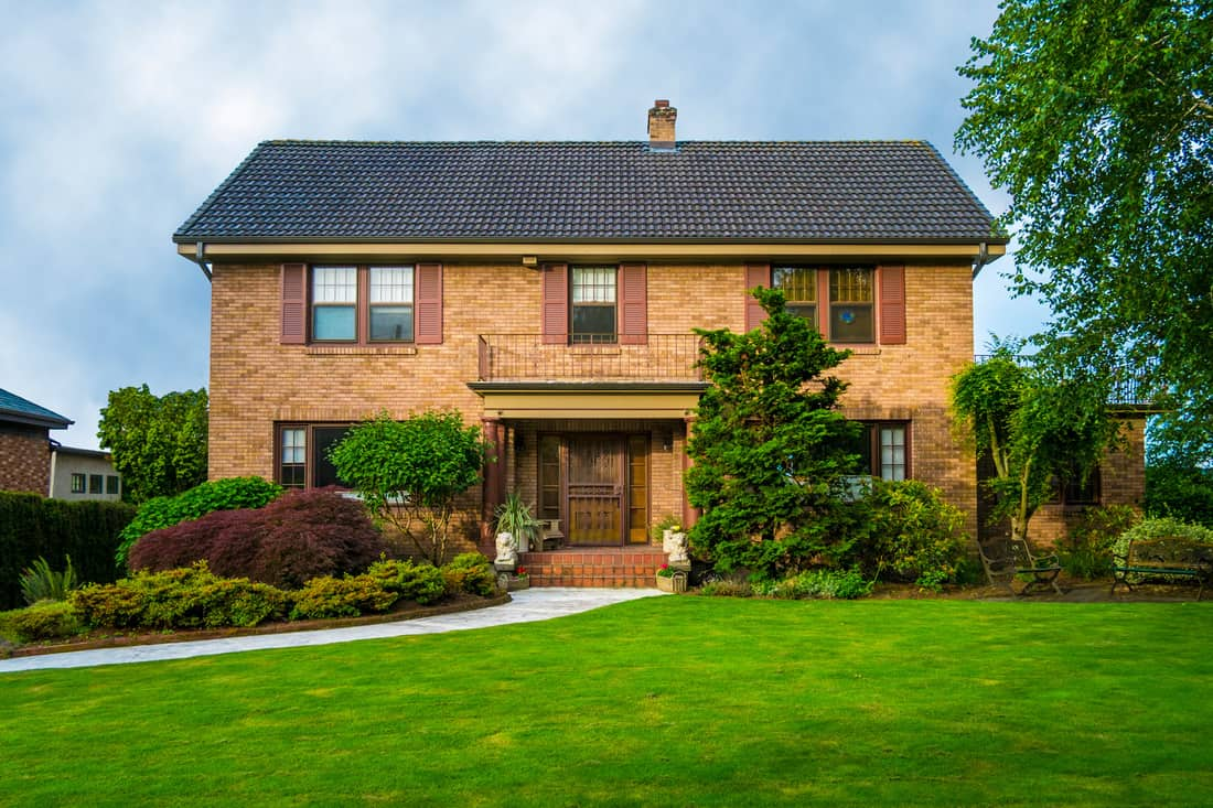 A gorgeous house with brick cladding and a gorgeous lawn
