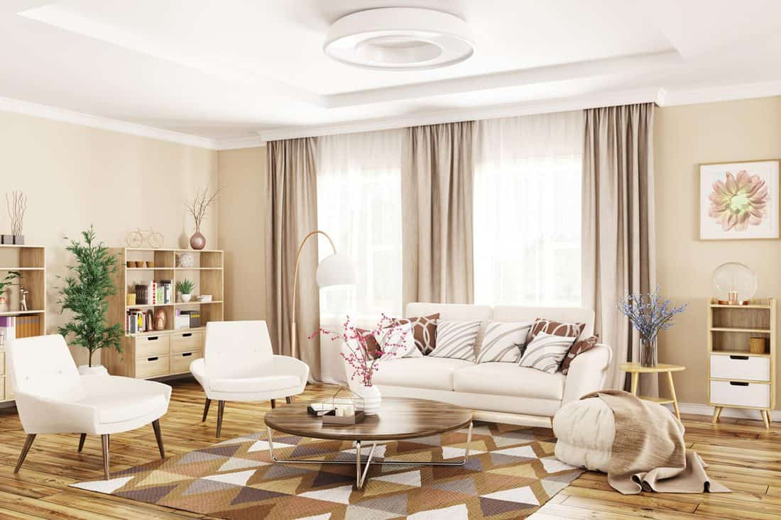 A gorgeous living room with a beautiful sofa set and a beige colored curtain