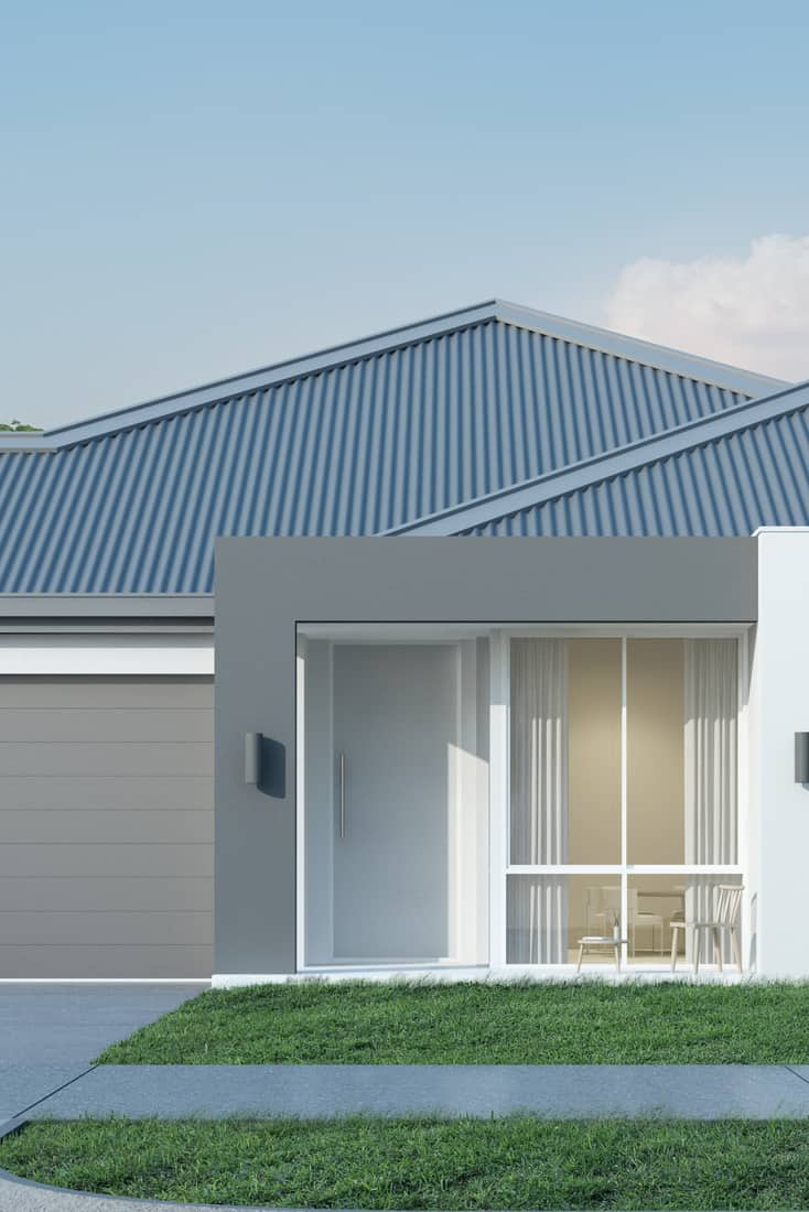 A gorgeous single storey modern house with a white door, huge windows, and a wide garage