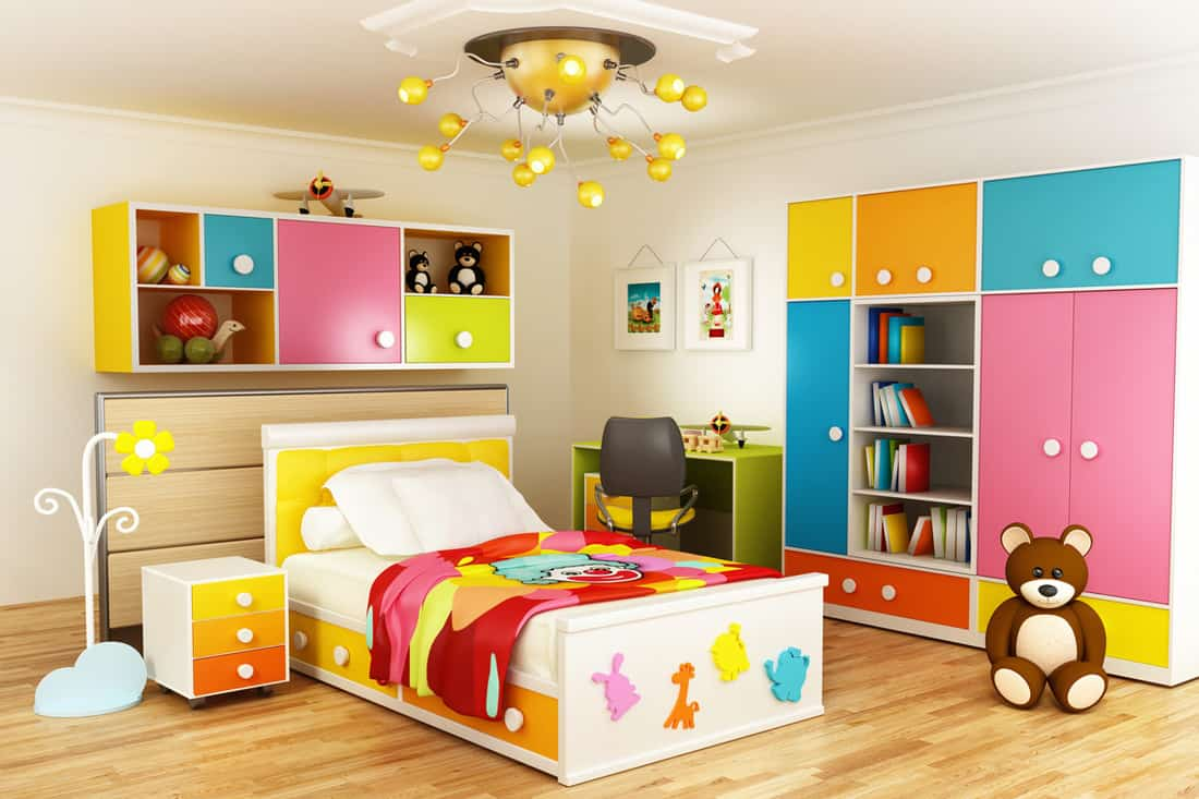 A kids bedroom with a colorful cabinet and bed