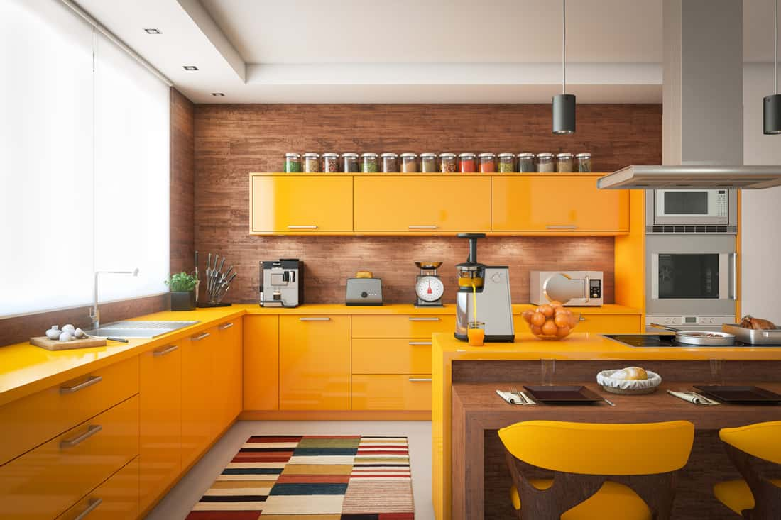 A kitchen with brown walls, yellow cabinets, and white ceilings