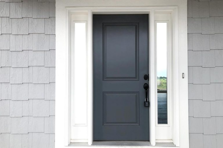 A modern front door with a white framing and a black painted door, Should Front Door Match Shutters and Trims?