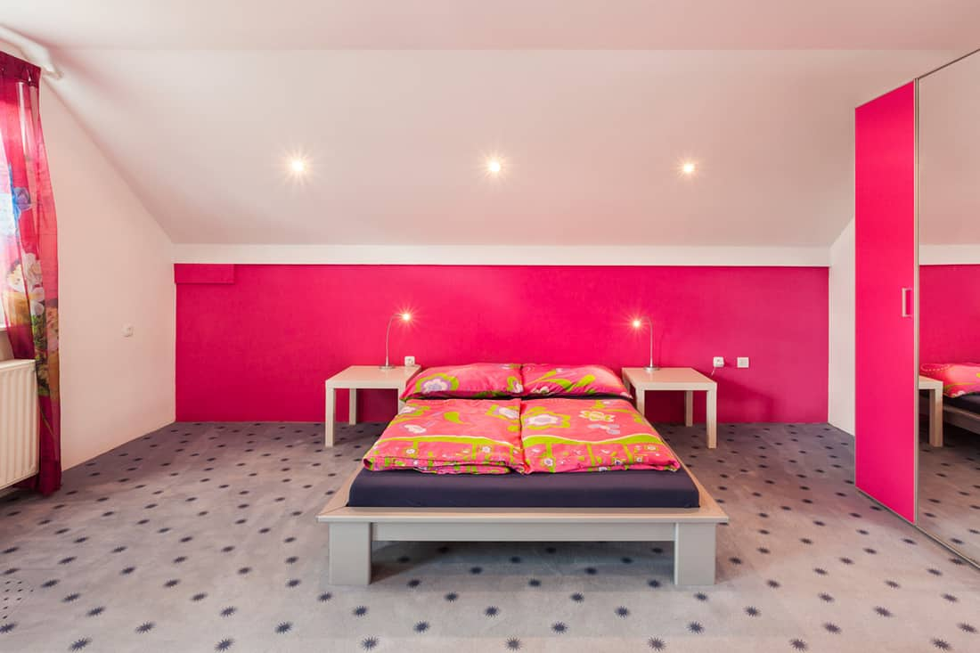 A pink and white ceiling room incorporated with a floral pattern flooring