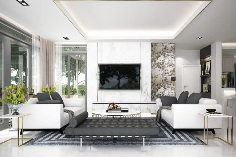 A white modern living room with two white sofas and black throw pillows, How to Arrange Two Sofas in Living Room