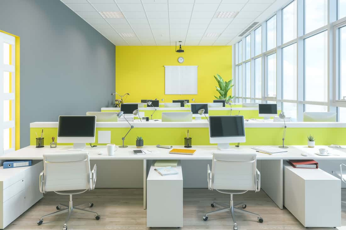 An office with a combination of white, yellow, and gray colors for better productivity