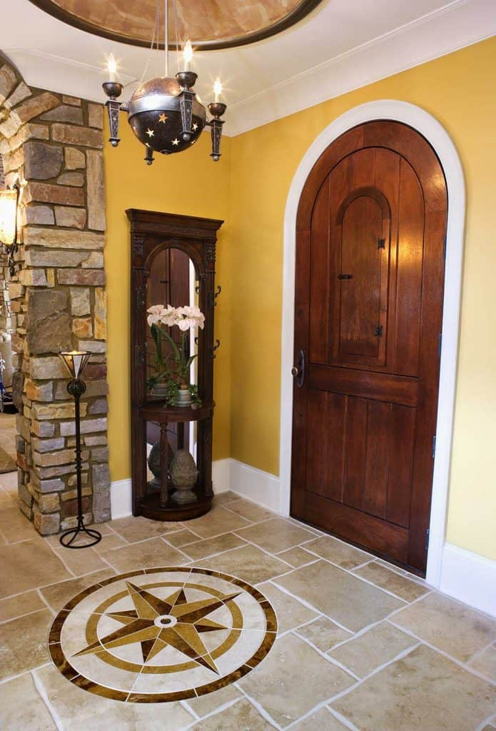 Arched front door and foyer of a luxury home