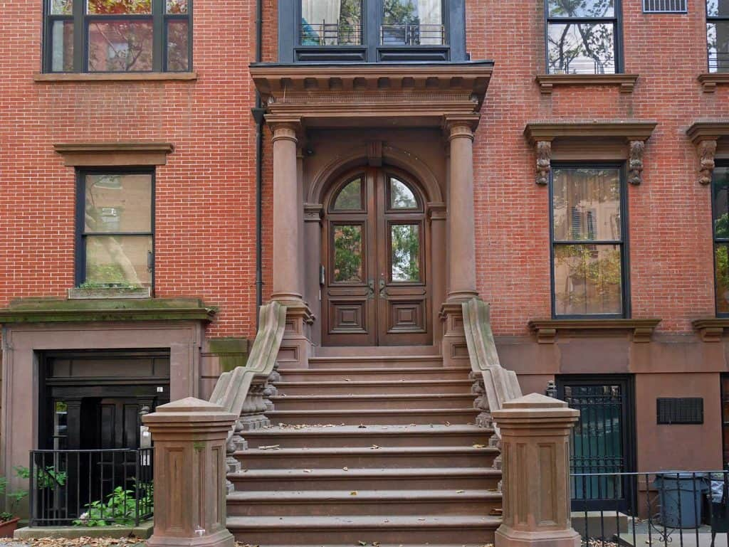 Arched front door of Brooklyn Heights historic brownstone building