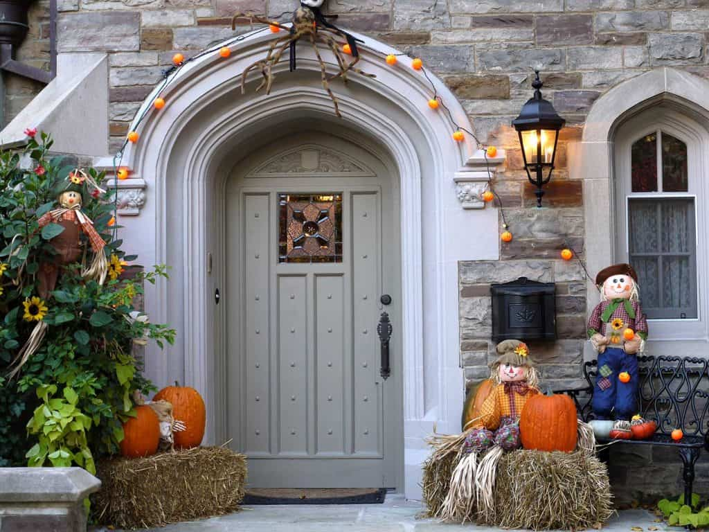 Arched front door with halloween decorations