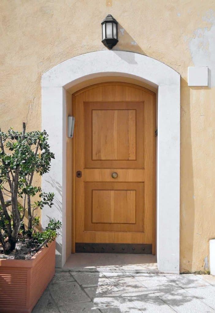 Arched wooden front door