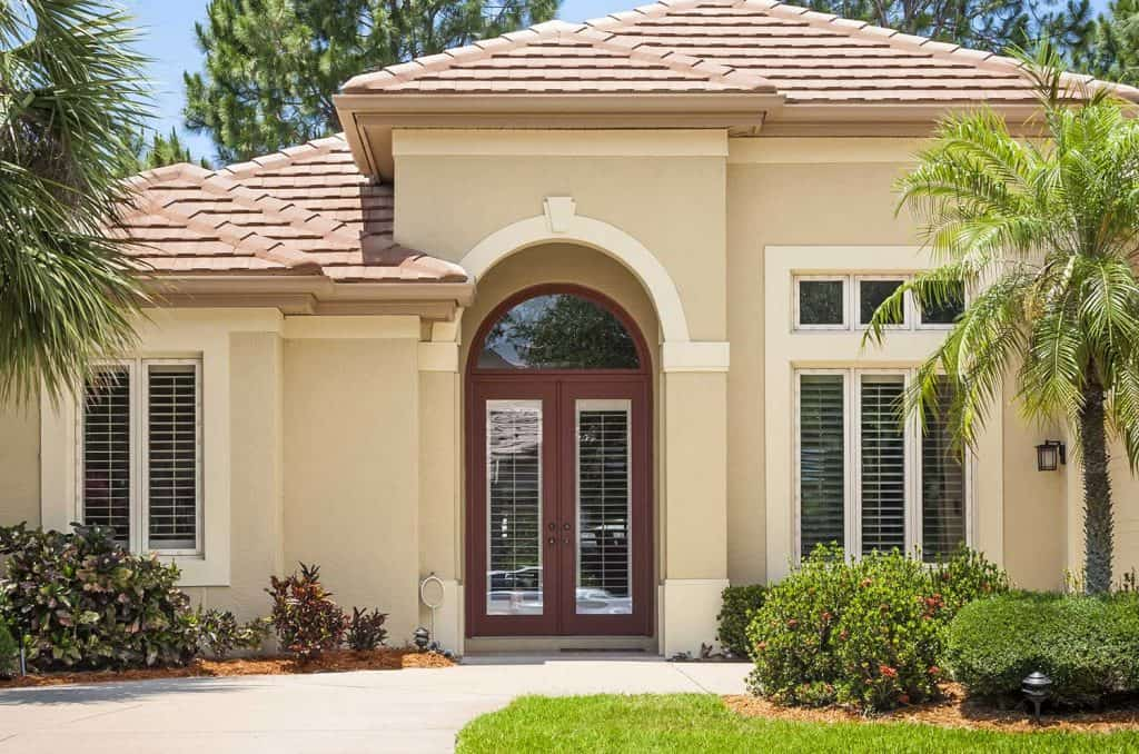 Beautiful new upscale home in the tropics with arched front door