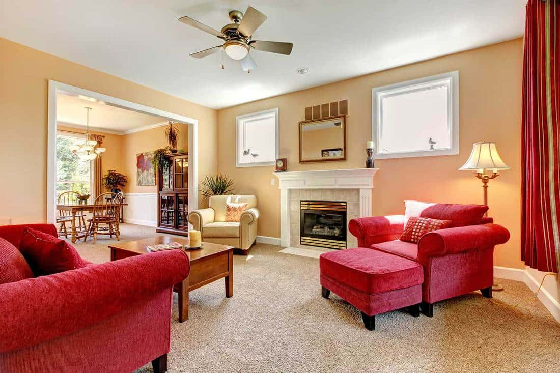 Beautiful peach and red living room interior with fireplace