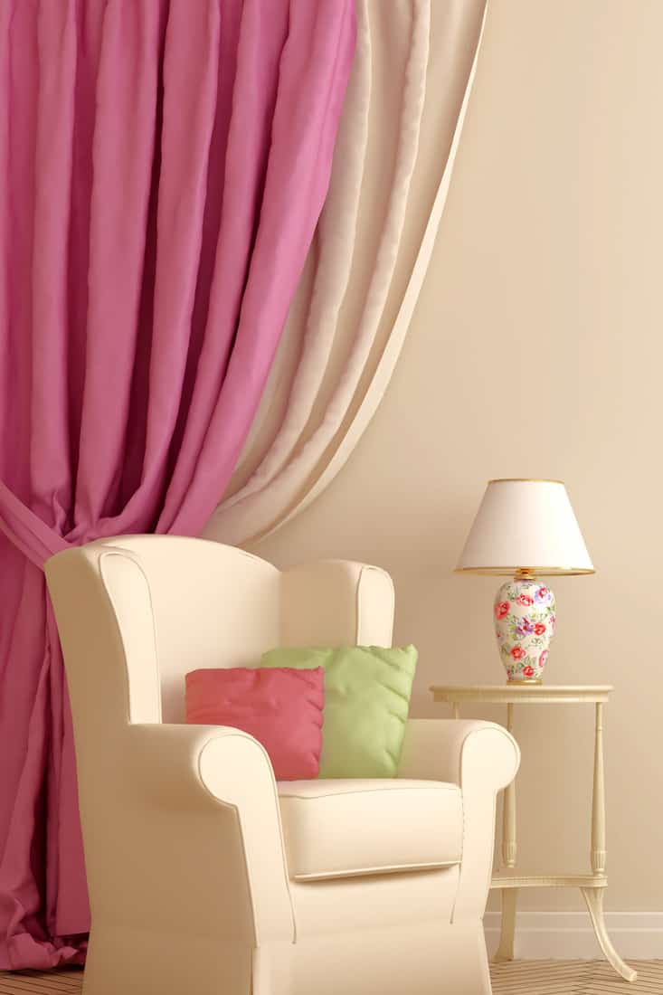 Beige colored walls with pinks curtains and beige curtains