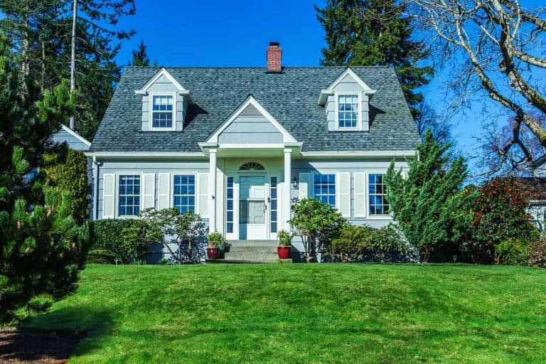 Blue colored colonial house with gorgeous front lawn, Front Door Color For A Blue House [Inc. 12 Photo Ideas]