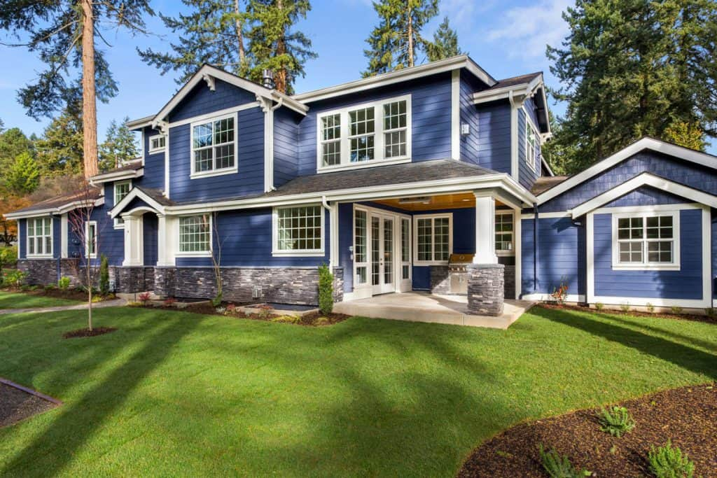 BLue colored modern colonial house with framed windows