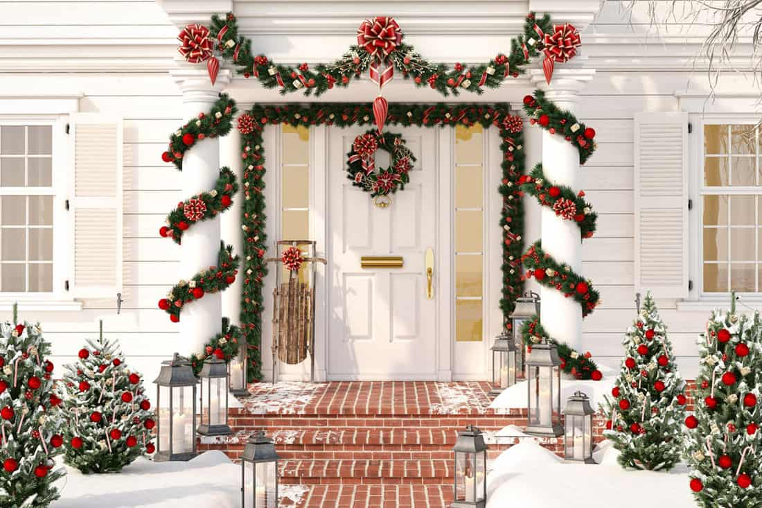 Christmas decorated porch with Christmas buntings and wreath at the door
