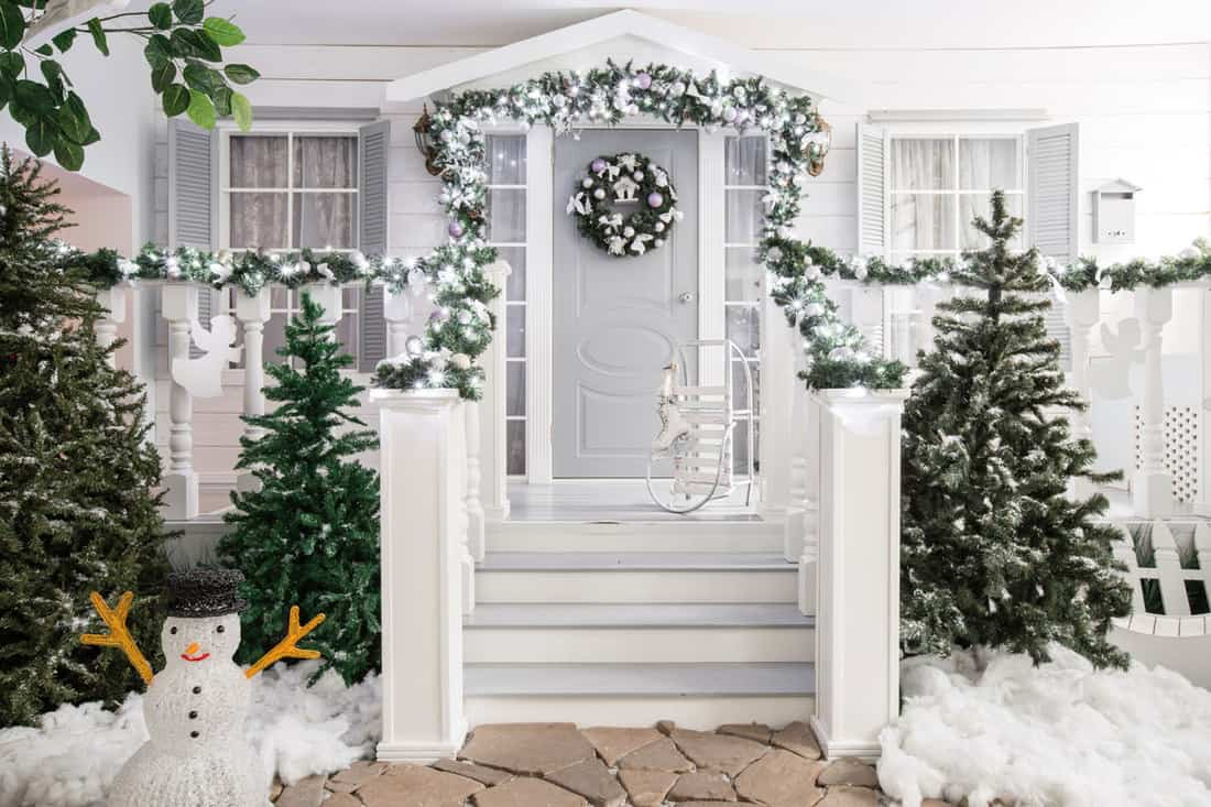 Christmas themed porch with wreath at the door
