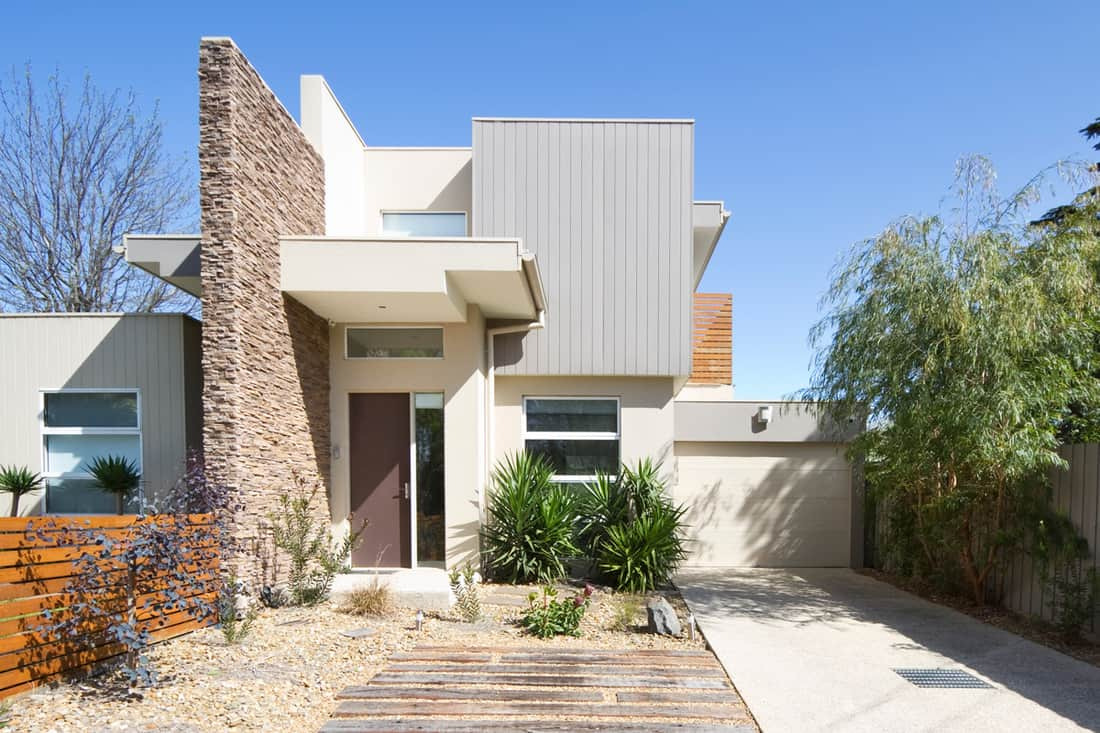 Contemporary house with white colored walls and brick cladding
