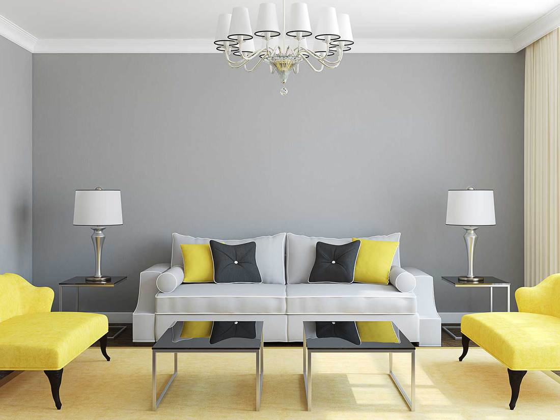 Contemporary living room interior with sofa, accent chairs, lamps and coffee tables