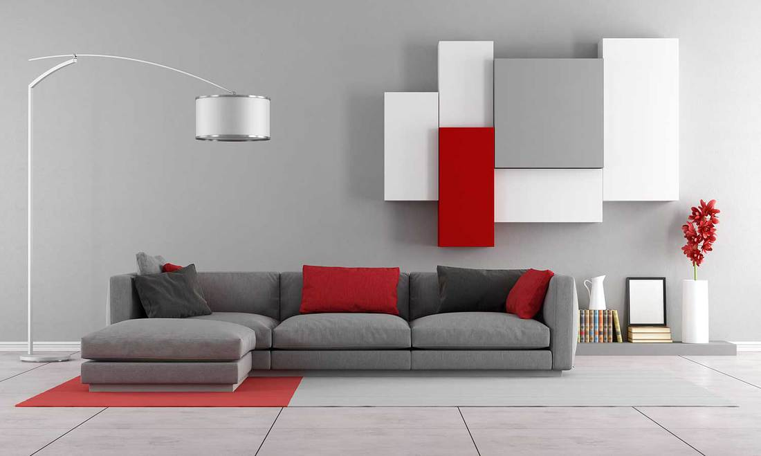 Contemporary lounge with gray sofa and wall unit on background