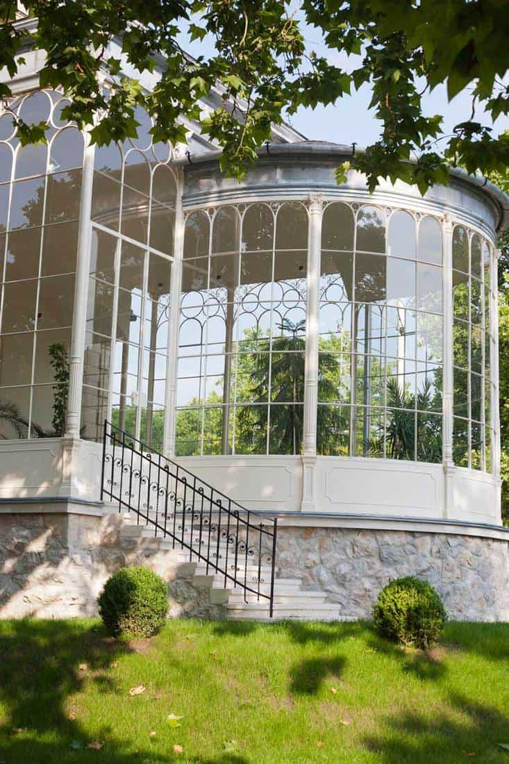 Curved glass wall on the front porch of a house