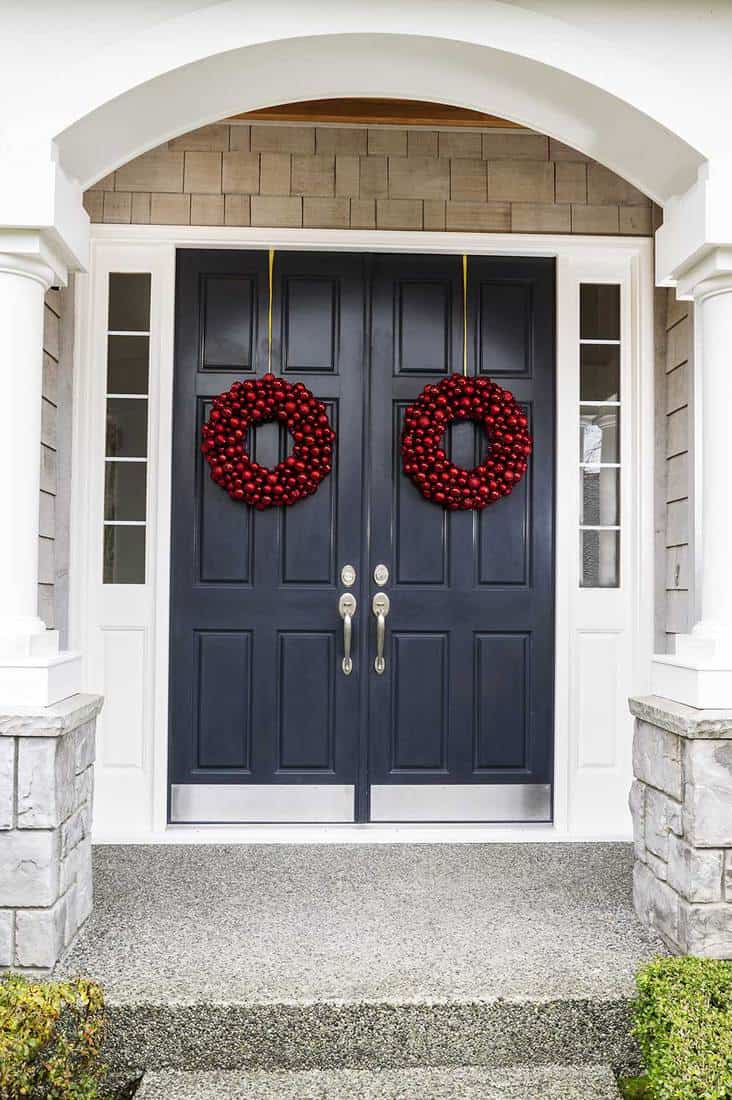 Double front door entrance with holiday decor