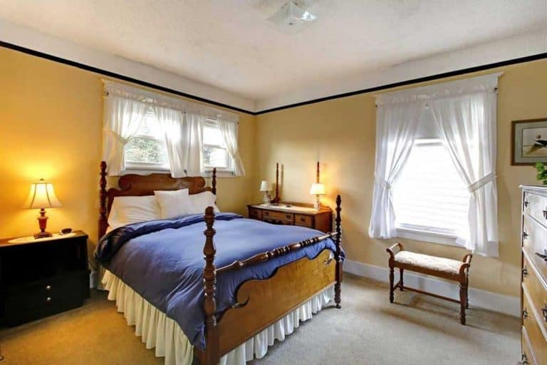 Elegant old english style bedroom with yellow walls, What Curtains Go With Yellow Walls? [Inc. 16 Photo Examples]