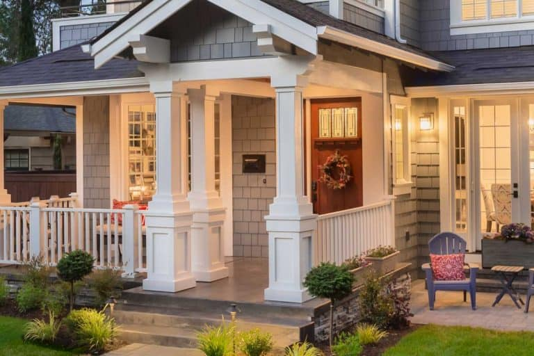 Front porch of a house with modern interior and christmas wreath on the front door, 31 Modern Front Porch Ideas You Should Check Out [Picture Post]