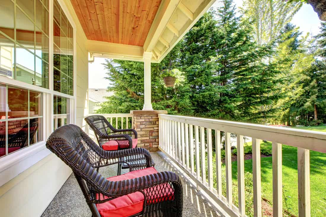 Front porch with black rattan chairs