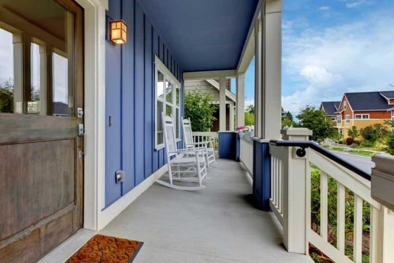 Front porch with gray door and blue color wall, 29 Covered Front Porch Designs [Inc. Colonial, Rustic and Modern]