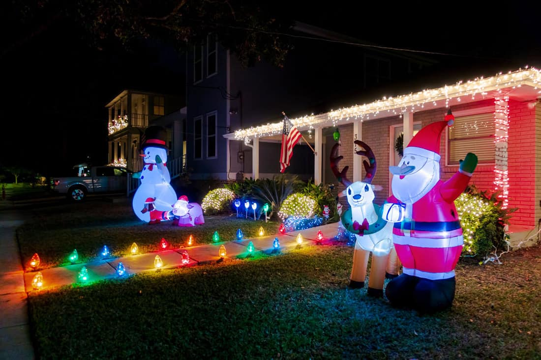 Front yard of a house decorated with Santa Claus and his Raindeer