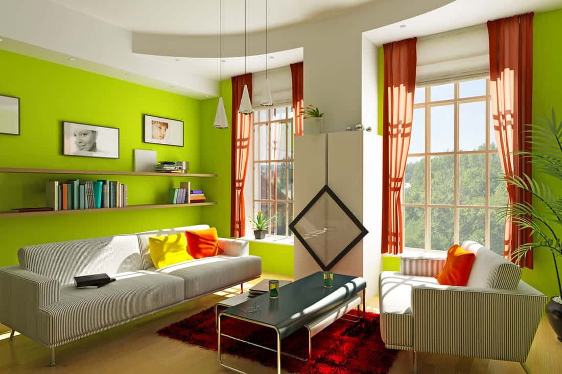 Green colored modern living room with two windows and striped couch