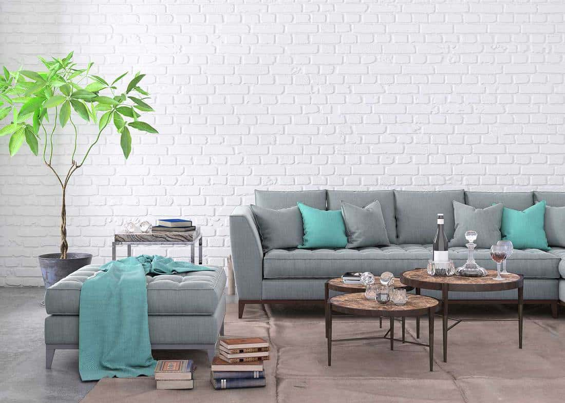 Home apartment living room interior with large sofa, lots of decor and elements, plant, vase, coffee table, carpet, pastel colors with many elements around