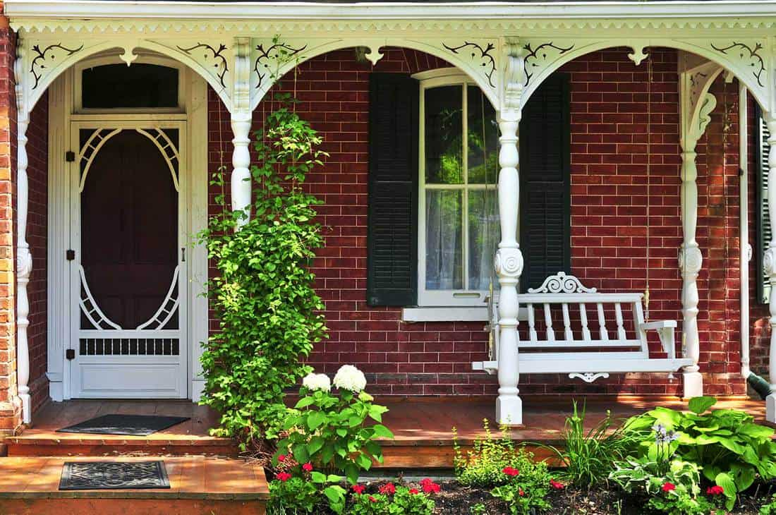 House porch with red brick walls