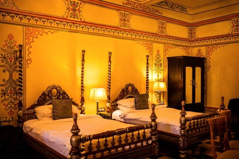 Indian themed bedroom with yellow lights and luxurious bed, Indian Themed Bedroom Ideas and Examples