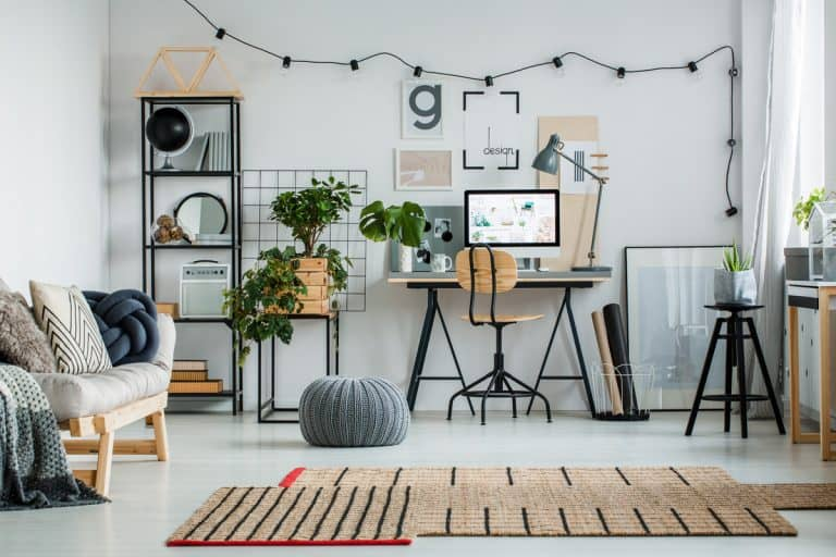 Industrial themed office with lights, gray pouf, and table with computer, 11 Gift Ideas For Mom's Office