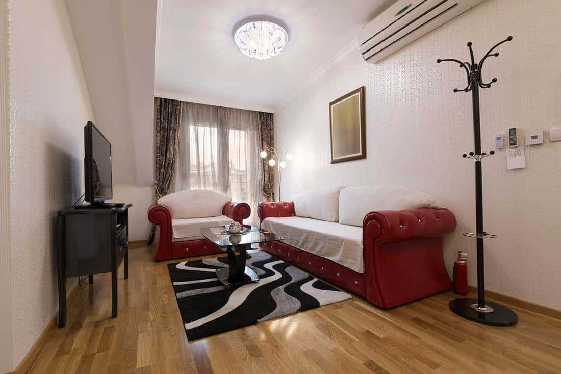 Interior of a hotel suite with red sofa set