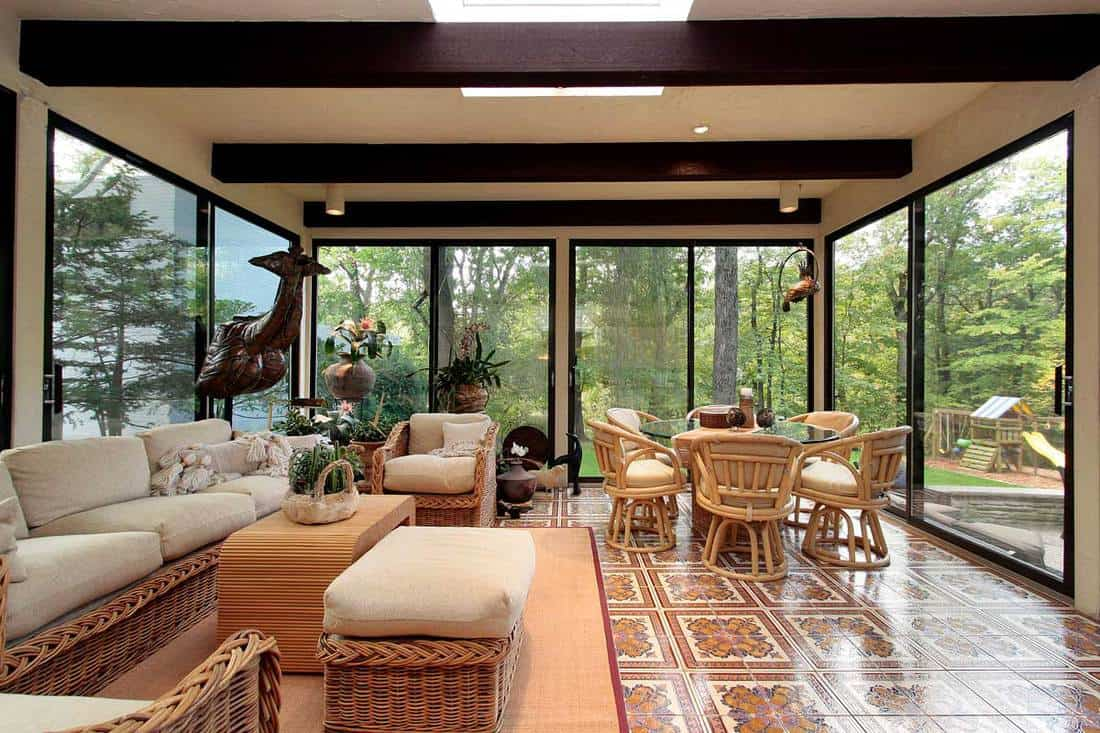 Living room with glass walling and gorgeous wooden furniture