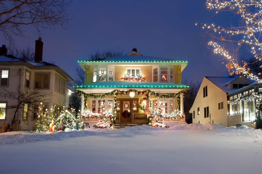 Luxurious house with Christmas lights attached on the porch and the fascia boards