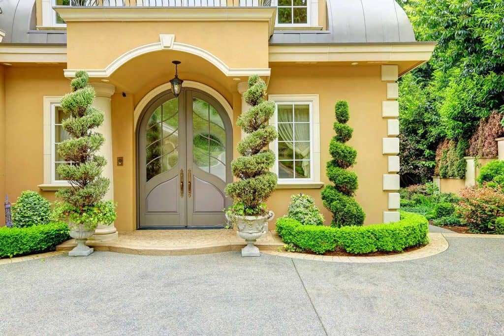 Luxury house exterior with arched front door