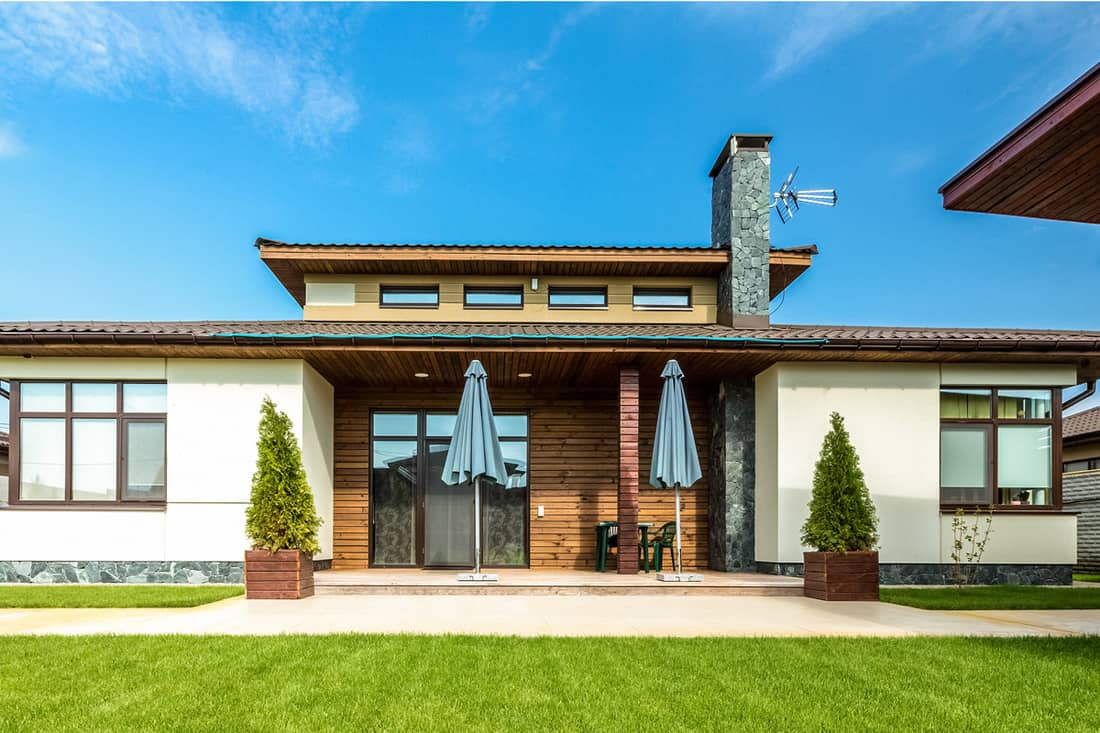 Modern contemporary two storey house with gorgeous front porch attached with wooden cladding