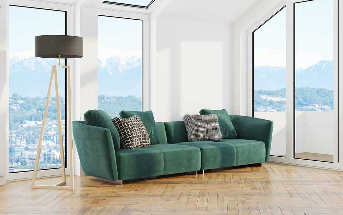 Modern design living room interior with green sofa and beautiful view