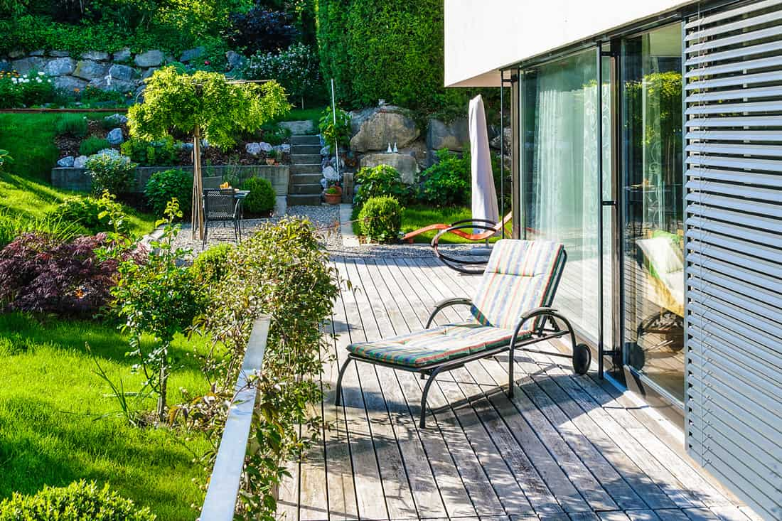 Modern front porch of a contemporary house and a beautiful garden