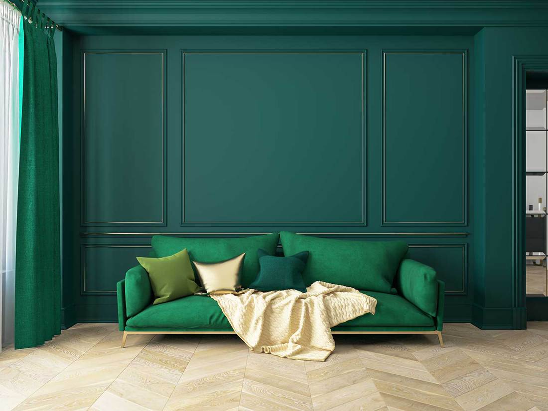 Modern green living room with sofa and parquet floor