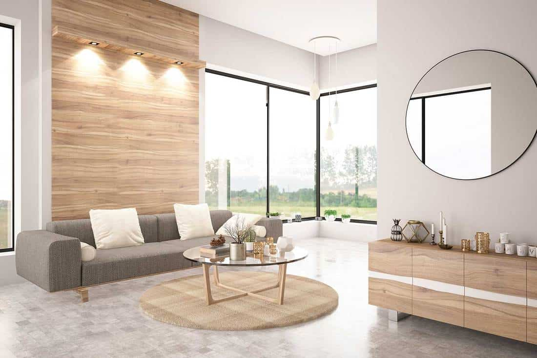 Modern living room interior with sofa and big round mirror