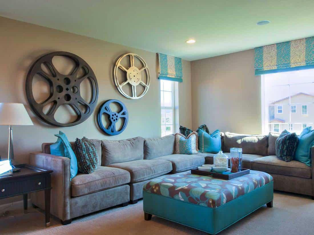 Modern living room with corner sofa and wheel rim wall decor